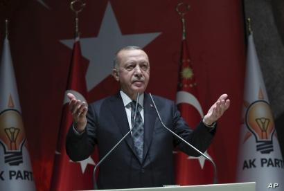Turkey's President Recep Tayyip Erdogan speaks to his ruling party officials, in Ankara, Turkey, Thursday, Oct. 10, 2019…