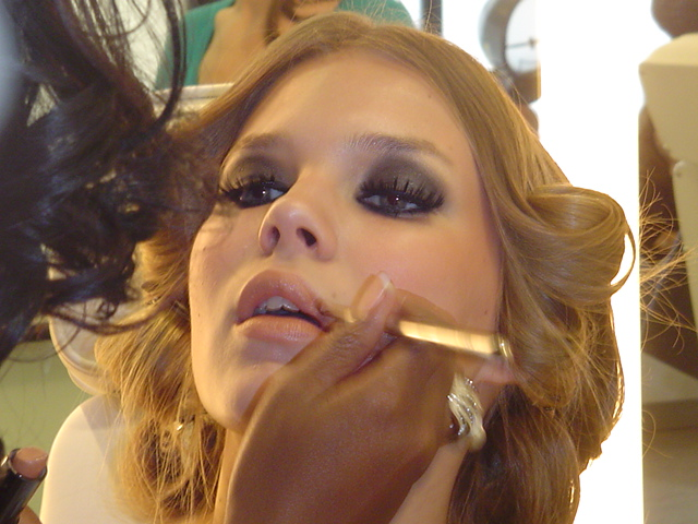 celebrity makeup artist brandy gomez duplessis works on a model from houston texas at a photo shoot