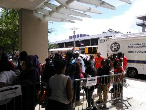 Baton Rouge residents stand in line at for assistance from the American Red Cross.