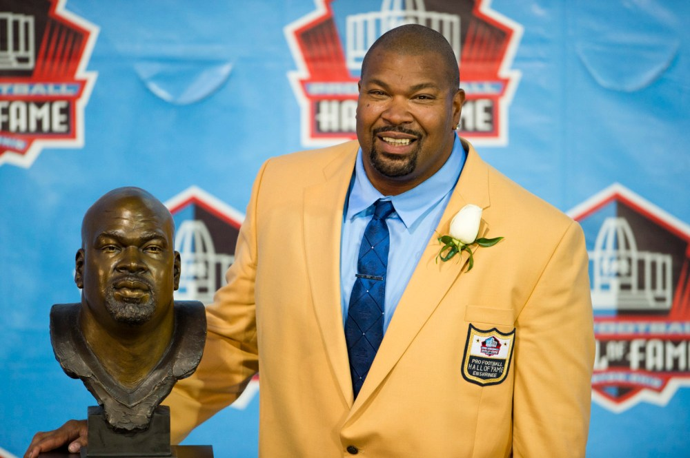 CANTON, OH - AUGUST 3: Former offensive lineman Larry Allen of the Dallas Cowboys poses with his Hall of Fame bust during the NFL Class of 2013 Enshrinement Ceremony at Fawcett Stadium on Aug. 3, 2013 in Canton, Ohio. (Photo by Jason Miller/Getty Images)