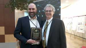 Siemens accepts CDCXA award in front of research posters