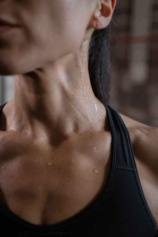 close up view of a woman sweating
