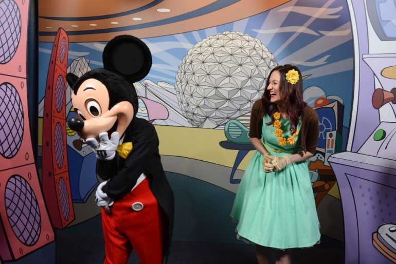 Mickey Mouse and Theresa standing next to each other, visibly laughing.