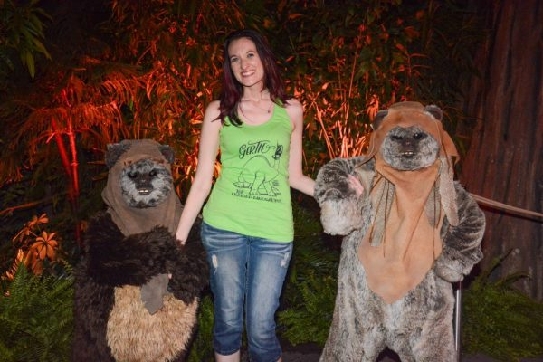 Theresa posing with two Ewoks from Star Wars in front of a forestl during DVC Moonlight Magic at Disney's Hollywood Studios