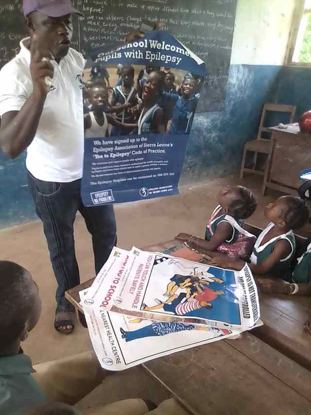 Two small children in a classroom learning about epilepsy