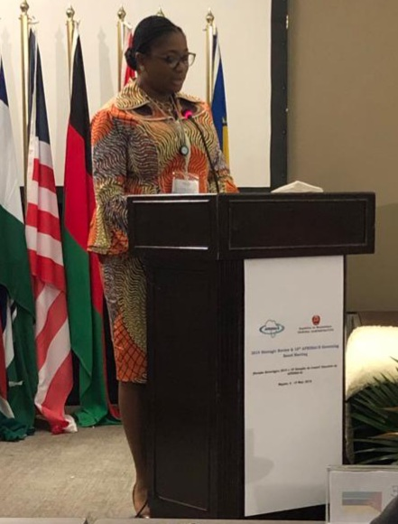 Lara Taylor-Pearce, Sierra Leone's Auditor General standing in front of podium giving a speech.
