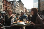 Two young Danish women in one of the many cafes and bars at the canal bank in Arhus. If the weather allows it, this part of the city becomes one of the busiest places downtown, for both locals and tourist visiting Aarhus.