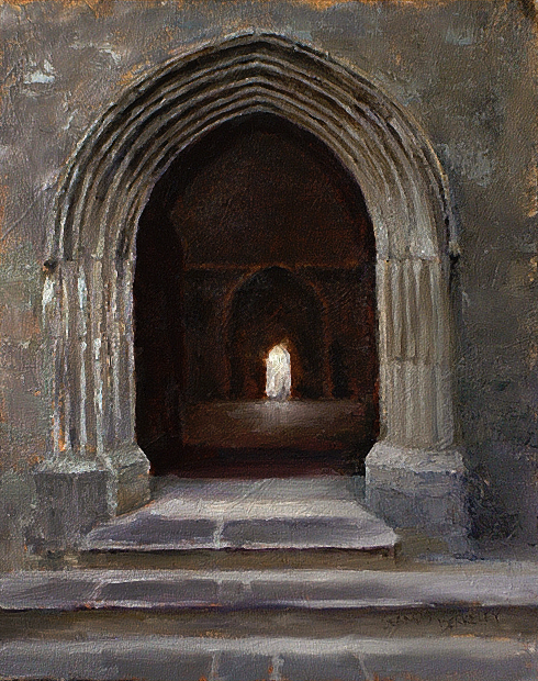 View through an open doorway of a distant doorway flooded with light at the Rock of Cashel Cathedral, Cashel, Ireland