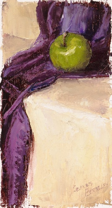 Still life oil painting of a green apple resting on a purple fabric set on a soft yellow background.