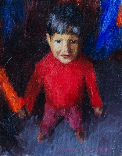 Oil painitng of a young boy living in Bikaner, Rajasthan, India in a bright red sweater looking upward.