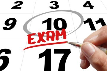 """A circle around a date on a calendar with the word """"exam"""" written on it."""