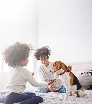 Image of mother, daughter, and dog