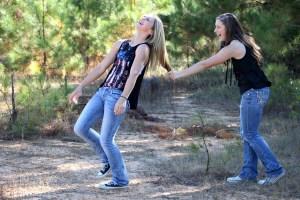 two teen girls laughing