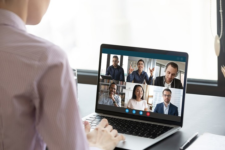 Video conference displayed on a laptop.