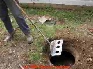 PHOTO of the septic tank muck raking tool used to break up scum and sludge layers during pumping.