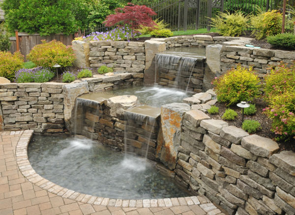 beautiful backyard waterfall and pond