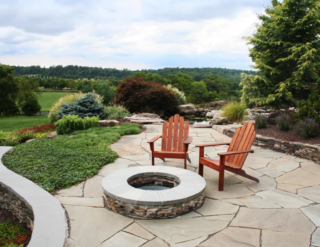 stacked stone fire pit with seating area