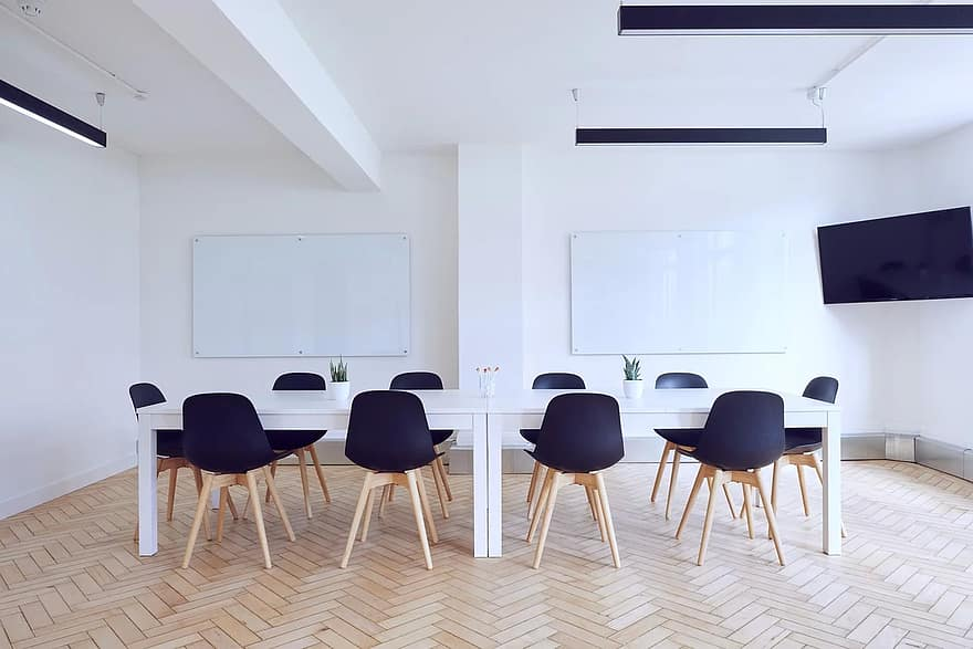 chairs conference room contemporary empty indoors interior design room table whiteboards