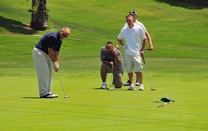 golfers golfing green putter putting caddy club ball course
