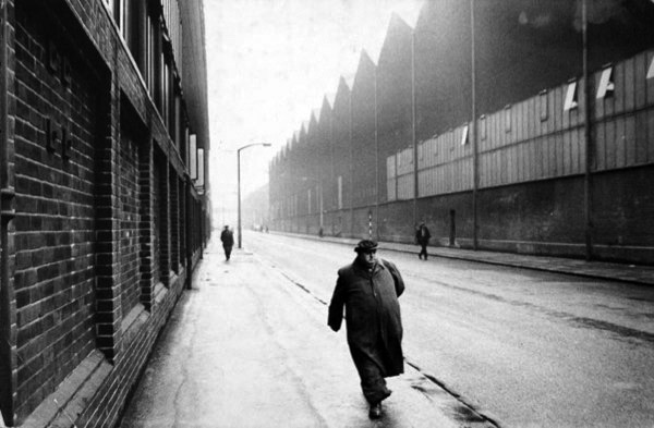 Man leaving a factory by Roger Mayne