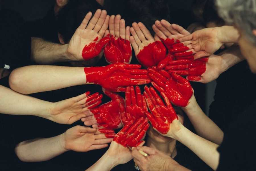 Symbol of a heart created with multiple hands