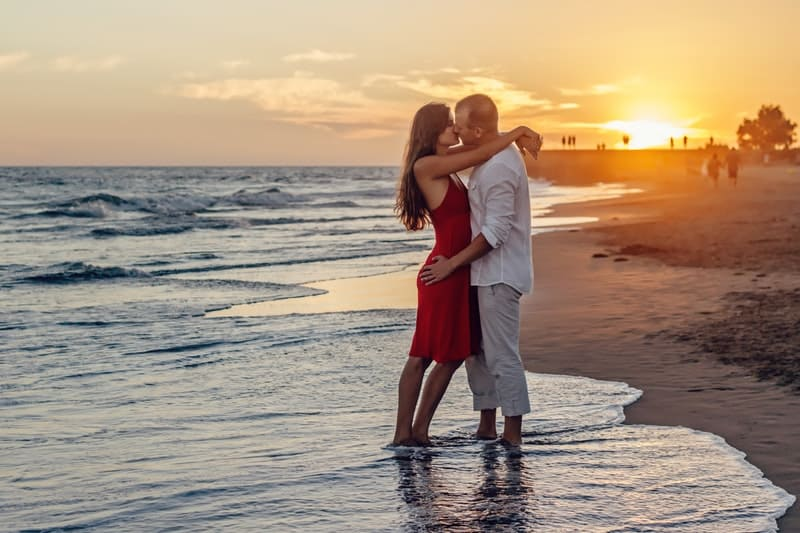 Romantic couple kissing during evening at the beach