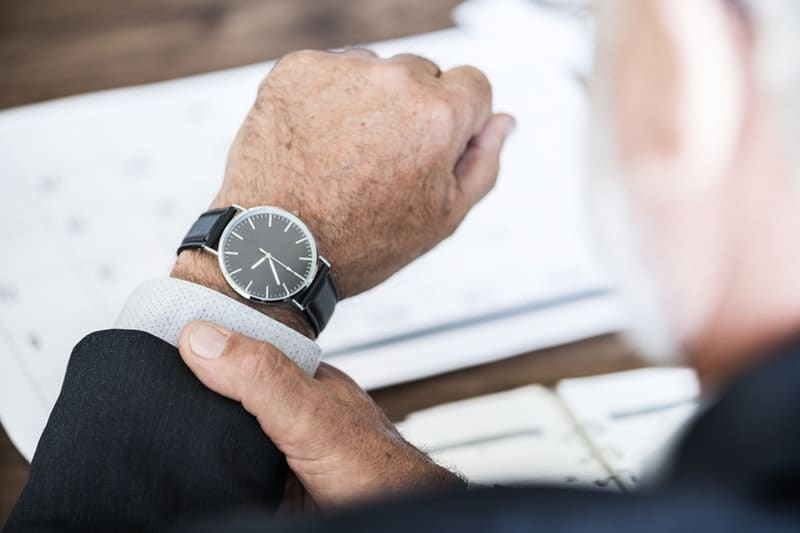 Selective Focus Photo of a Person Wearing Round Watch