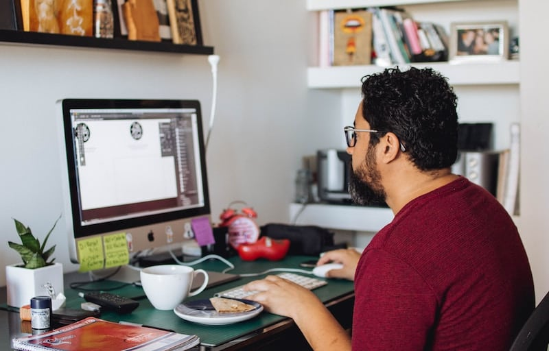 Graphic Designers Working with Adobe Illustrator in His Home Office