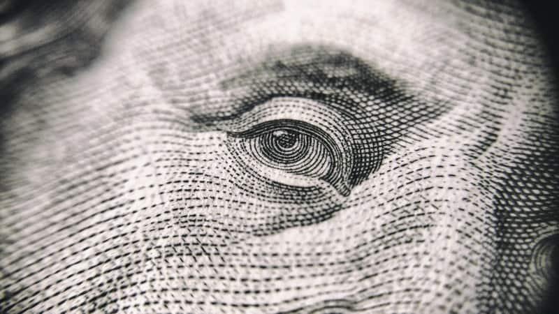 eye of benjamin franklin on the 100 dollar bill