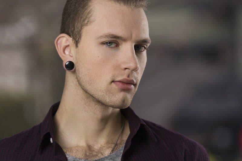 Man Wearing Button Earrings
