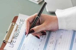 Person Filling out a Life Insurance Form