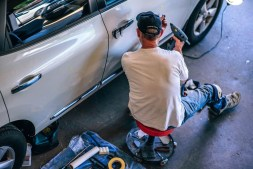 Man Fixing the body of a car