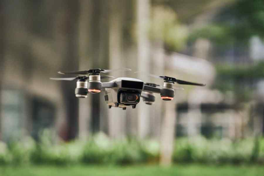 black and silver drone quadcopter