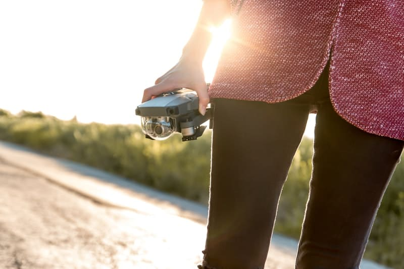 woman holding a modern drone in her hand