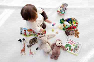 Adorable Kid Playing with Toys