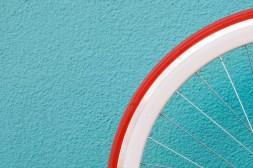 Minimal bike tire against a blue background