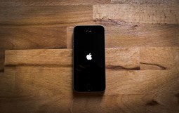 Iphone 5 with the apple logo on screen