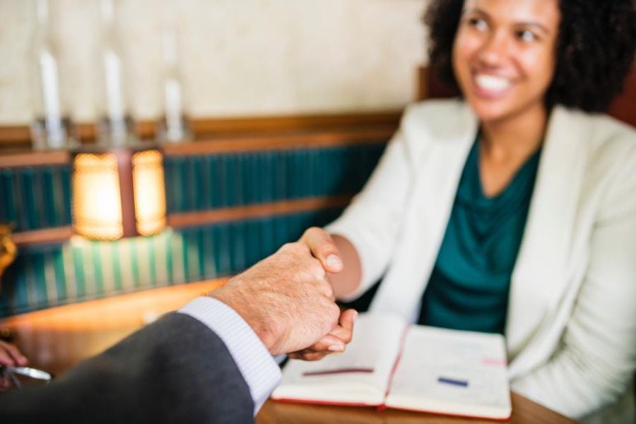 Woman shaking a lawyers hand