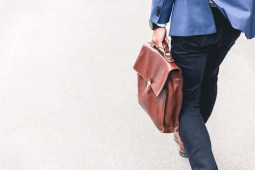 Man Carrying a Leather Briefcase