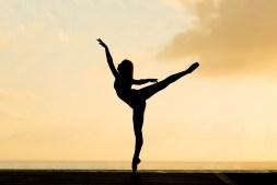 Woman Dancing During Sunset