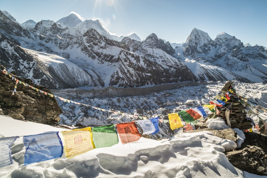 A great view of the sunrising behind Mt. Everest from the summit of Gokyo Ri.
