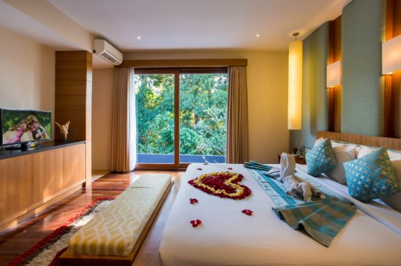 7. honeymoon set up - flower petal on the bed