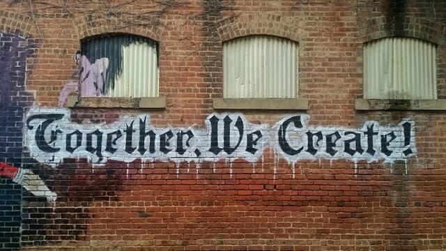 advantages-teamwork-graffiti-brick-wall-together-we-create