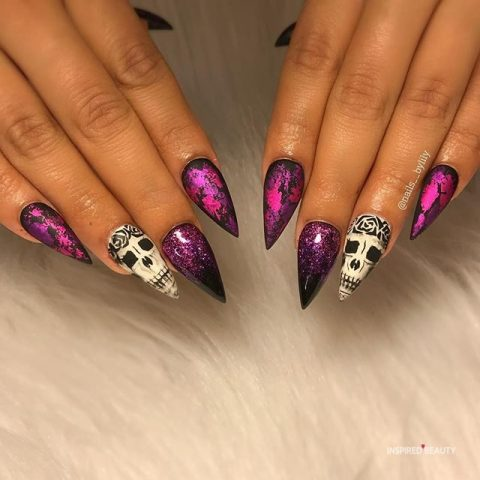 Purple Pointy nails with skull design