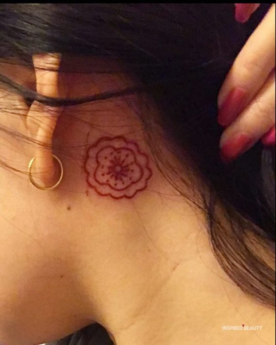 Cute Behind the Ear red ink Tattoo