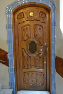 The doors were specially designed and carved for this house. The handles were hand wrought so that when you hold it, it fits perfectly with your fingers/hand