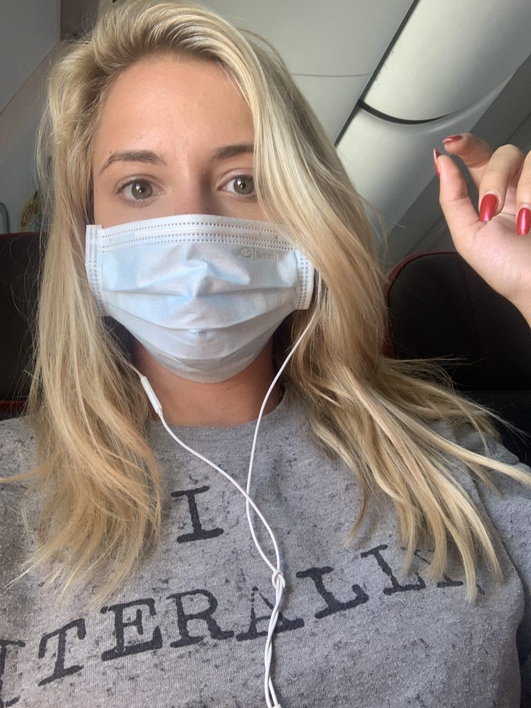 On plane with a mask on