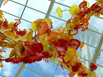 Chihuly Glass Flowers With Space Needle In Background
