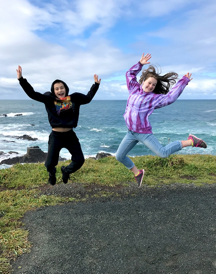 Carter and Natalie Bourn Jumping In The Air Along the Northern California Coast