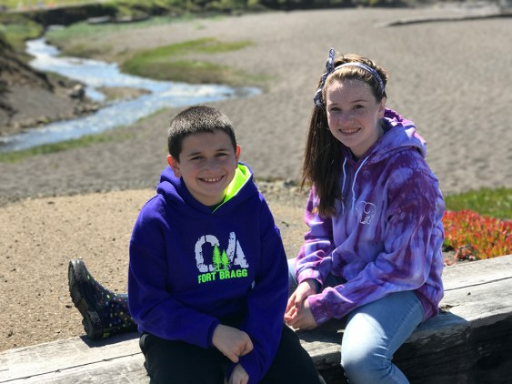 Carter and Natalie Bourn Resting on a log at MacKerricher State Park